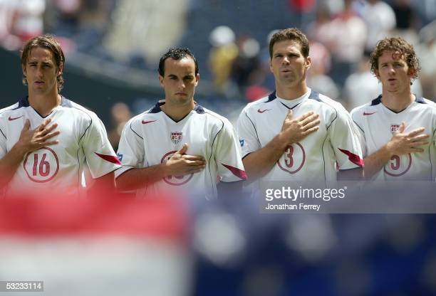 Josh Wolff#16 Landon Donovan Greg Vanney John O'Brien of the United States line up for the singing of the national anthem prior to the game against...