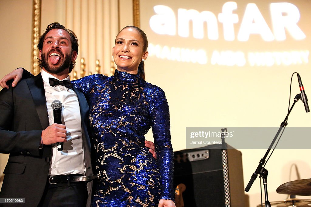 Josh Wood (L) and <a gi-track='captionPersonalityLinkClicked' href=/galleries/search?phrase=Jennifer+Lopez&family=editorial&specificpeople=201784 ng-click='$event.stopPropagation()'>Jennifer Lopez</a> recipient of the Humanitarian award, speak on stage during the 4th Annual amfAR Inspiration Gala New York at The Plaza Hotel on June 13, 2013 in New York City.