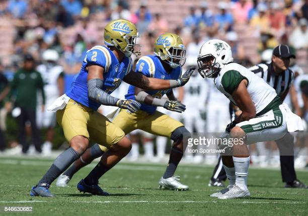 Josh Woods tries to break through the line during a college football game between the Hawai'i Rainbow Warriors and the UCLA Bruins on September 09...