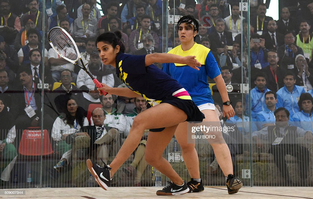 Joshana Chiappa (L) of India and Pakistan's Maria Toorpaki Waxir play in the women's squash final at the 12th South Asian Games 2016 in Guwahati on February 8, 2016. Chiappa won the gold. AFP PHOTO/ Biju BORO / AFP / BIJU BORO