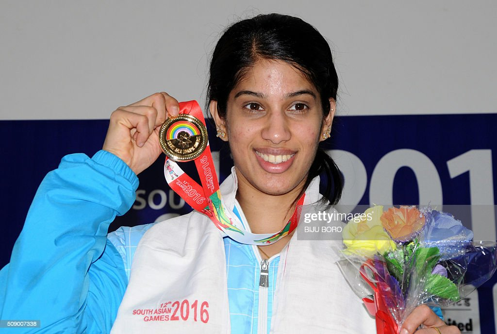 Joshana Chiappa of India displays her gold medal after winning the women's squash event at the 12th South Asian Games 2016 in Guwahati on February 8, 2016. AFP PHOTO/ Biju BORO / AFP / BIJU BORO