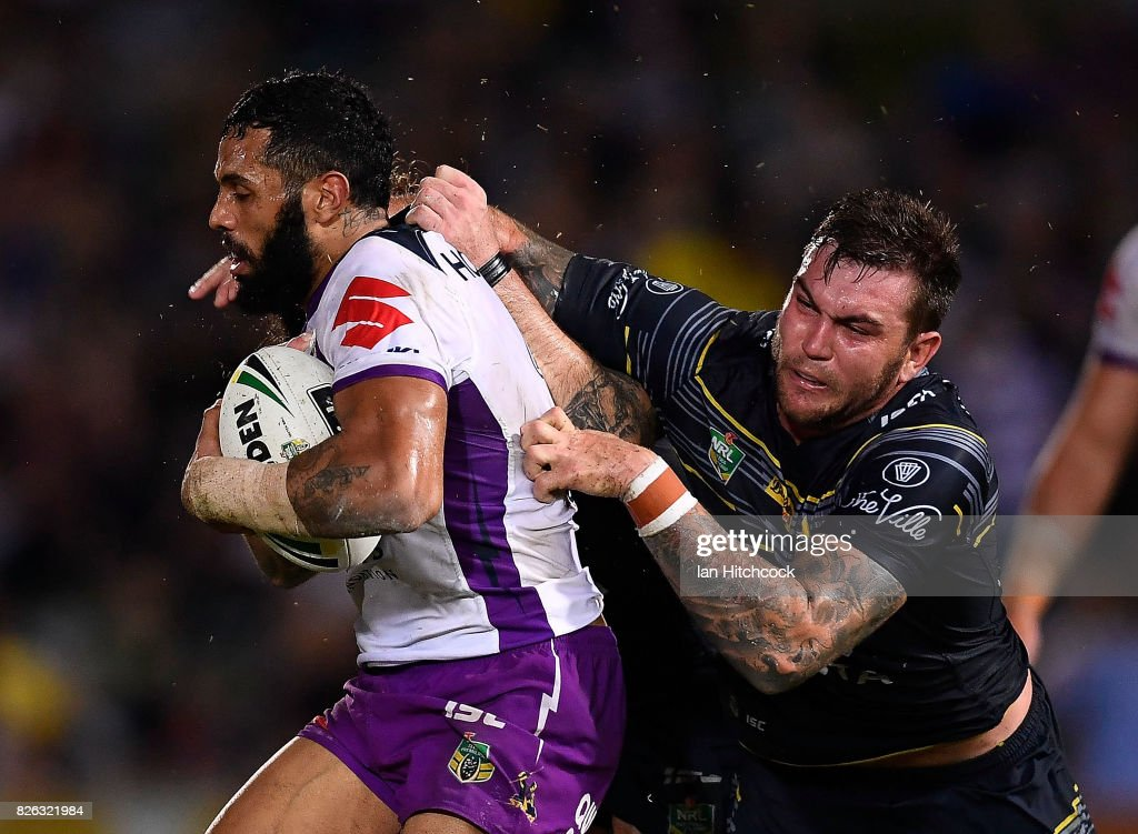 Joshua Addo-Carr of the Storm makes a break past Kyle Feldt of the Cowboys which lead to him scoring a try during the round 22 NRL match between the North Queensland Cowboys and the Melbourne Storm at 1300SMILES Stadium on August 4, 2017 in Townsville, Australia.