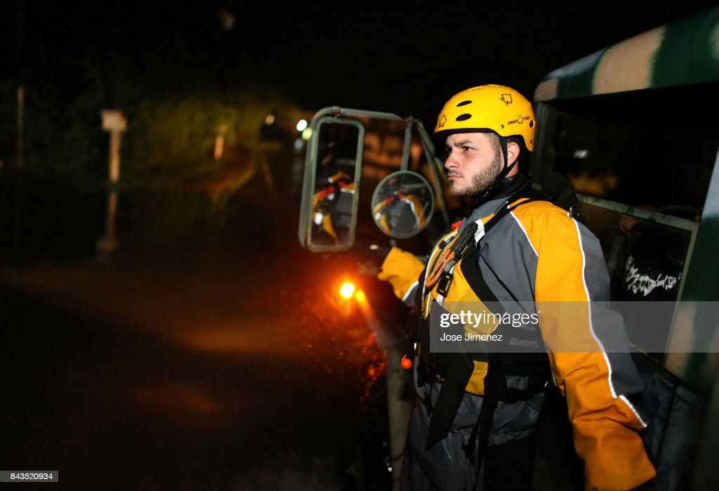 Joshua Alicea, a member of a rescue team from the local emergency management agency inspects flooded areas after the passing of Hurricane Irma on September 6, 2017 in Fajardo, Puerto Rico. The category 5 storm is expected to pass over Puerto Rico and the Virgin Islands today, and make landfall in Florida by the weekend.