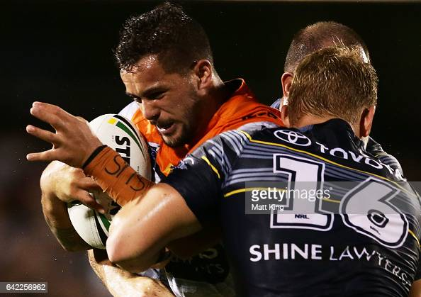 Joshua Aloiai of the Tigers is tackled during the NRL Trial match between the Wests Tigers and the North Queensland Cowboys at Campbelltown Stadium...