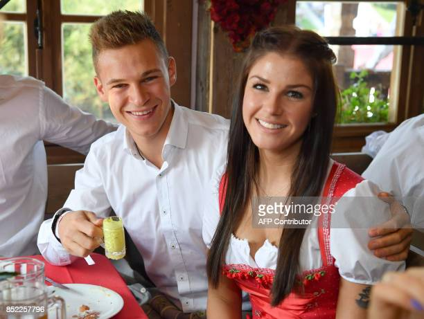 Joshua Bayern Munich's German midfielder Joshua Kimmich and his girlfriend Lina Meyer pose during the traditional visit of FC Bayern Munich to the...