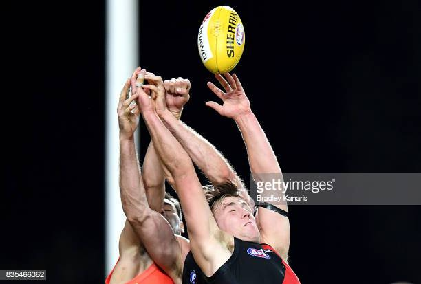 Joshua Begley of the Bombers competes for the ball during the round 22 AFL match between the Gold Coast Suns and the Essendon Bombers at Metricon...
