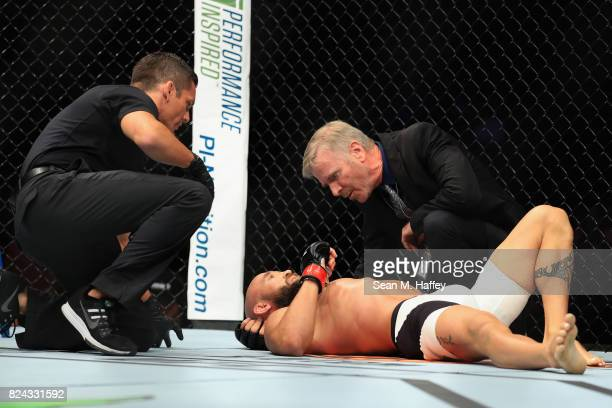 Joshua Berkman is tended to after being defeated by Drew Dober during their Flyweight bout at UFC 214 at Honda Center on July 29 2017 in Anaheim...