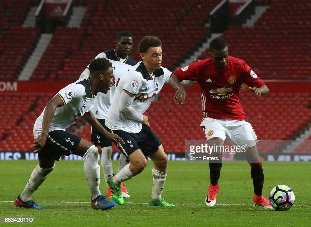 Joshua Bohui of Manchester United U23s in action with Luke Amos of Tottenham Hotspur during the Premier League 2 match between Manchester United U23s...