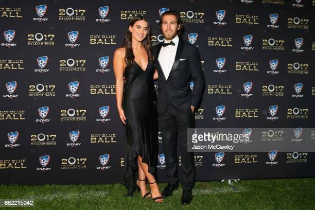 Joshua Brillante and Lucy Miller arrive at the 2017 Sky Blue Ball at Sydney Cricket Ground on May 12 2017 in Sydney Australia