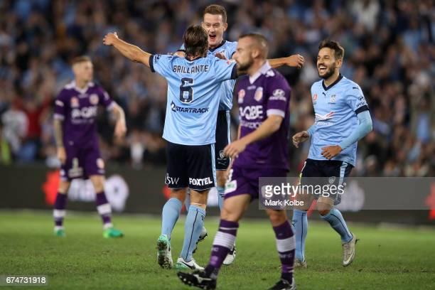 Joshua Brillante Brandon O'Neill and Milos Ninkovic of Sydney FC celebrate Joshua Brillante scoring a goal during the ALeague Semi Final match...