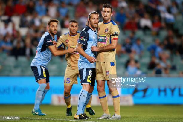 Joshua Brillante of Sydney and Jason Hoffman of the Jets during the round seven ALeague match between Sydney FC and Newcastle Jets at Allianz Stadium...