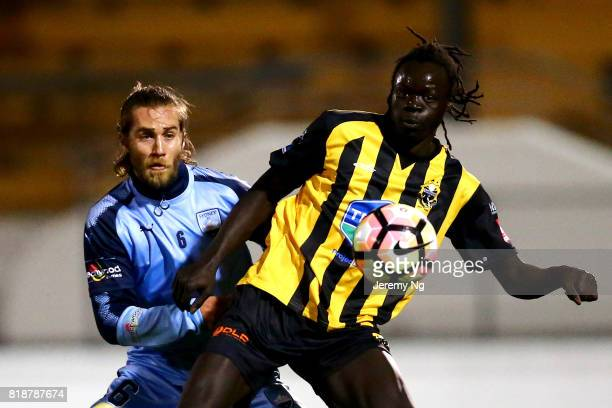 Joshua Brillante of Sydney FC and Garang Awac of the Wanderers challenge for the ball during the 2017 Johnny Warren Challenge match between Sydney FC...