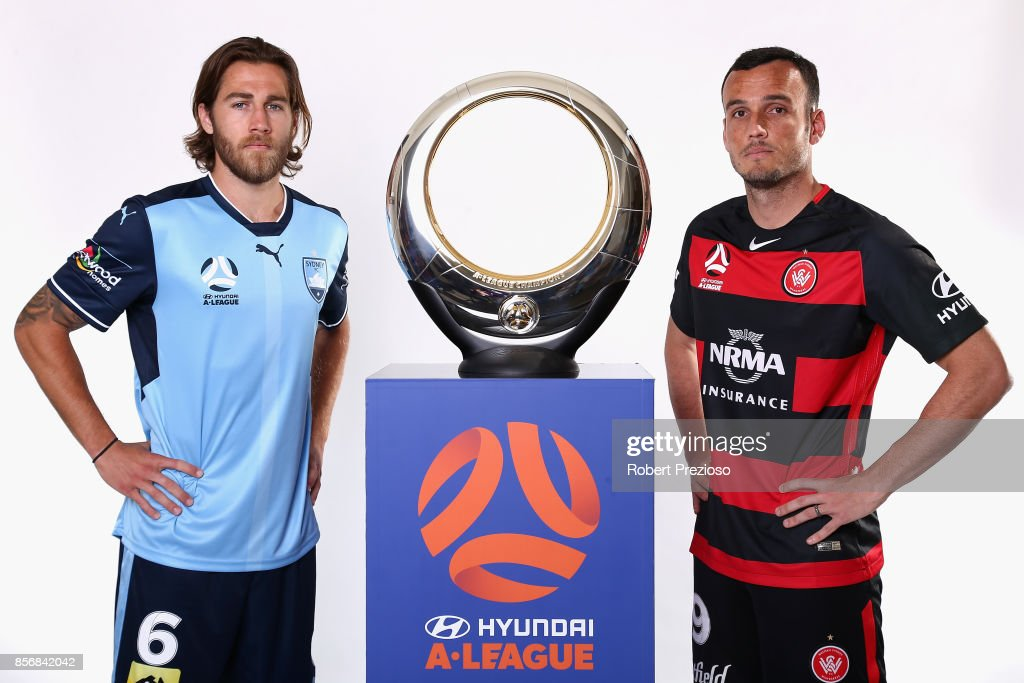 Joshua Brillante of Sydney FC and Mark Bridge of Western Sydney Wanderers pose during the 2017/18 A-League Season Launch at Port Melbourne SC on October 3, 2017 in Melbourne, Australia.