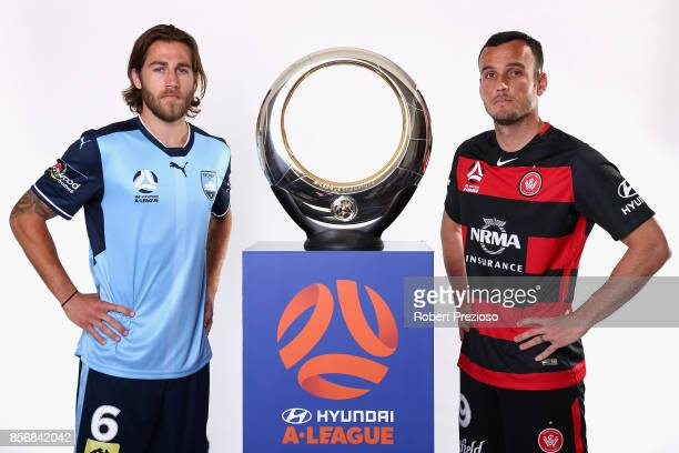 Joshua Brillante of Sydney FC and Mark Bridge of Western Sydney Wanderers pose during the 2017/18 ALeague Season Launch at Port Melbourne SC on...