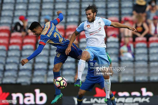 Joshua Brillante of Sydney FC contests the header against John Koutroumbis of the Jets during the round nine ALeague match between the Newcastle Jets...