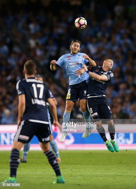 Joshua Brillante of Sydney FC is challenged by Besart Berisha of Melbourne Victory during the 2017 ALeague Grand Final match between Sydney FC and...