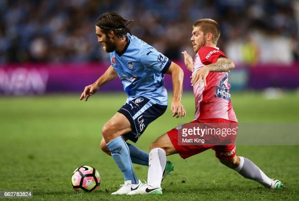 Joshua Brillante of Sydney FC is challenged by Luke Brattan of Melbourne City during the round 25 ALeague match between Sydney FC and Melbourne City...