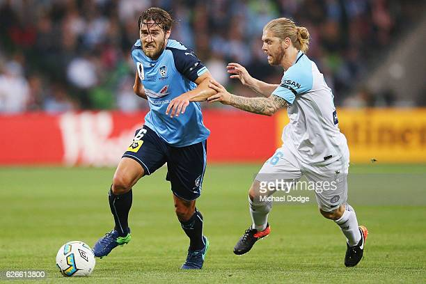 Joshua Brillante of Sydney FC runs with the ball past Luke Brattan of the City during the FFA Cup Final match between Melbourne City FC and Sydney FC...