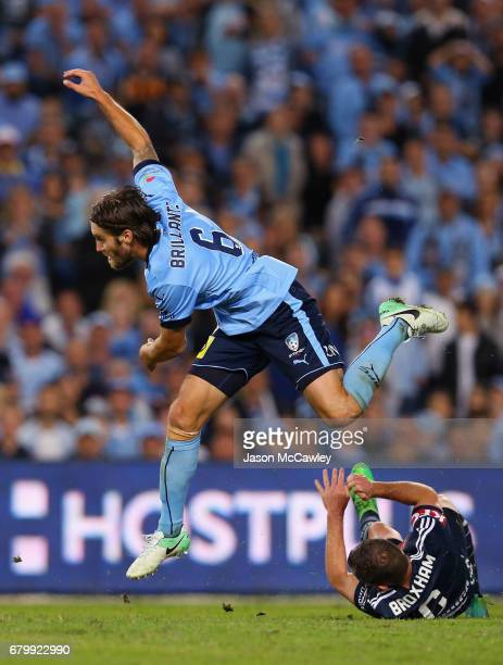 Joshua Brillante of Sydney is challenged by Leigh Broxham of the Victory during the 2017 ALeague Grand Final match between Sydney FC and the...