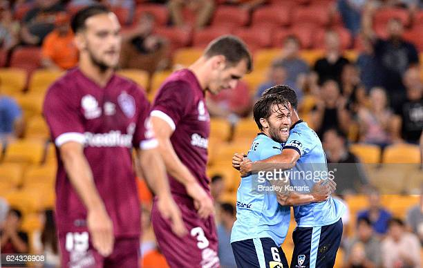 Joshua Brillante of Sydney is congratulated by team mates after scoring a goal during the round seven ALeague match between the Brisbane Roar and...