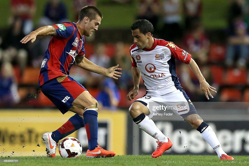 Joshua Brillante of the Jets contests the ball against Sergio Cirio of Adelaide United during the round 27 A-League match between the Newcastle Jets and Adelaide United at Hunter Stadium on April 11, 2014 in Newcastle, Australia.
