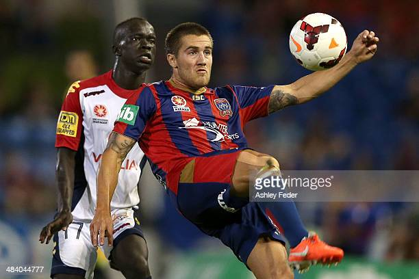 Joshua Brillante of the Jets contests the header against Awer Mabil of Adelaide United during the round 27 ALeague match between the Newcastle Jets...