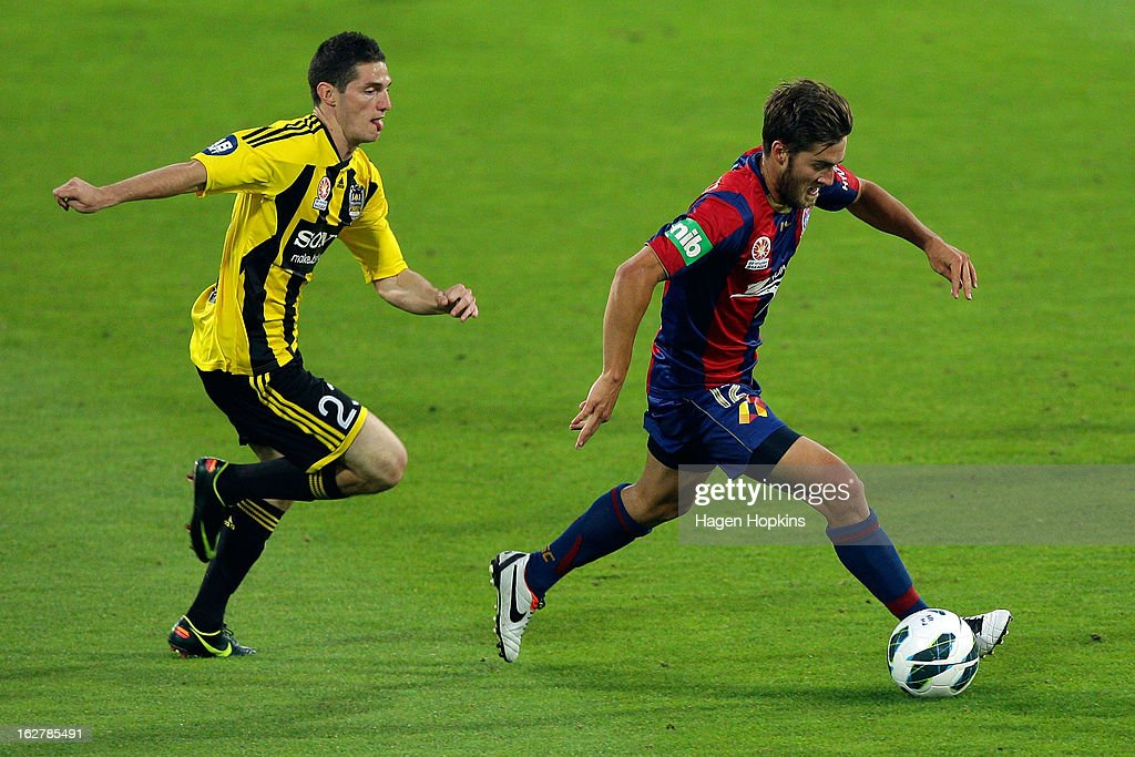 Joshua Brillante of the Jets makes a break under pressure from Corey Gameiro of the Phoenix during the round 26 A-League match between the Wellington Phoenix and the Newcastle Jets at Westpac Stadium on February 27, 2013 in Wellington, New Zealand.