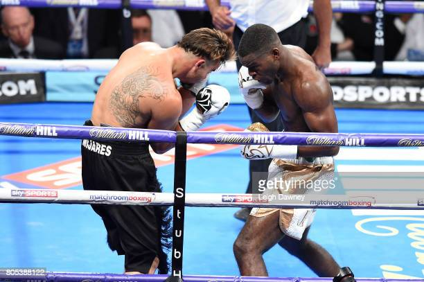 Joshua Buatsi in boxing action with Carlos Mena during a Light Heavyweight contest at The O2 Arena on July 1st 2017 in London England