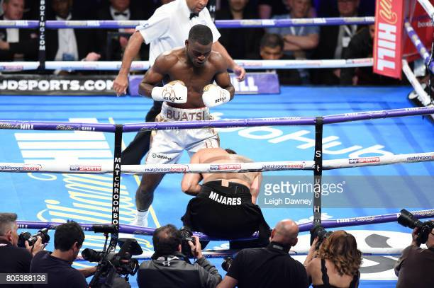 Joshua Buatsi makes his professional debut and knocks down Carlos Mena during a Light Heavyweight contest at The O2 Arena on July 1st 2017 in London...