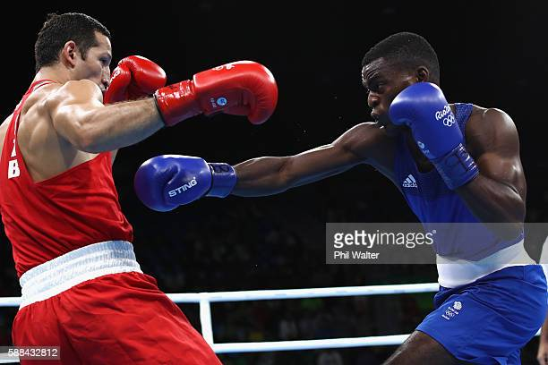 Joshua Buatsi of Great Britain fights Eishoot Rasulov of Uzbekistan in their Mens Light Heavyweight bout on Day 6 of the 2016 Rio Olympics at...