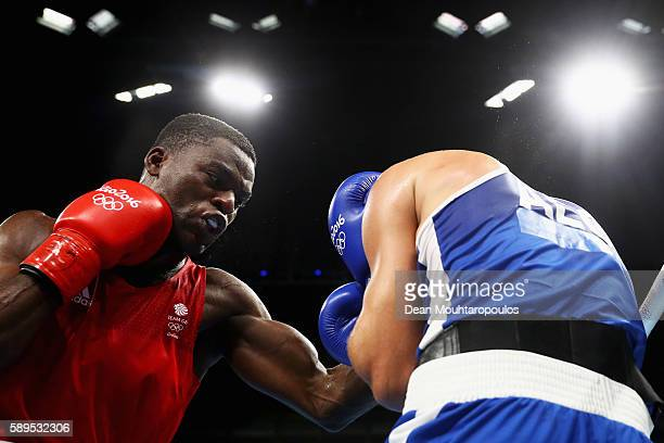 Joshua Buatsi of Great Britain or Team GB and Abdelhafid Benchabla of Algeria compete in their Light Heavyweight 81kg men boxing bout on Day 9 of the...
