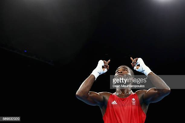 Joshua Buatsi of Great Britain or Team GB celebrates victory over Abdelhafid Benchabla of Algeria after they compete in their Light Heavyweight 81kg...
