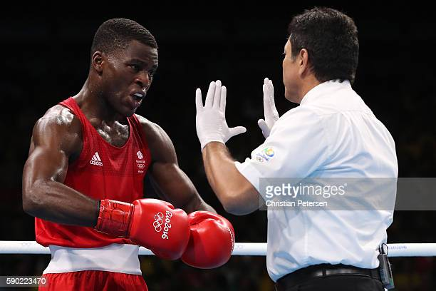 Joshua Buatsi of Great Britain works with an official during the Men's Light Heavy Semifinal 2 on Day 11 of the Rio 2016 Olympic Games at Riocentro...
