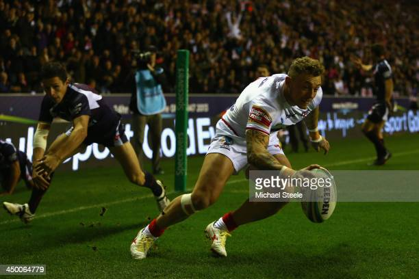 Joshua Charnley of England scores his sides opening try during the Rugby League World Cup Quarter Final match between England and France at the DW...