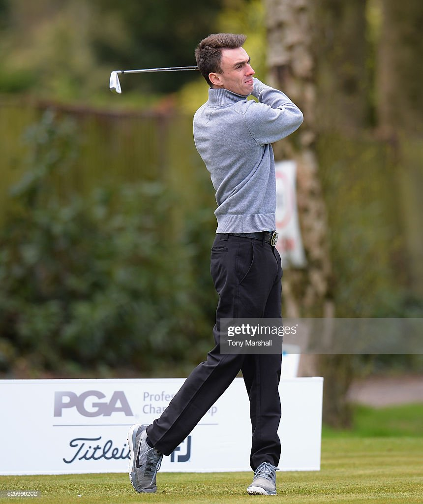 Joshua Charnock of Shrewsbury Golf Club plays his first shot on the 1st tee during the PGA Professional Championship - Midland Qualifier at Little Aston Golf Club on April 29, 2016 in Sutton Coldfield, England.