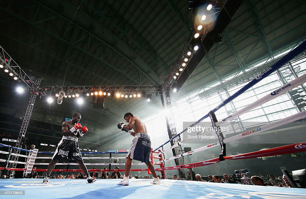 Joshua Clottey of Ghana and Jorge Silva of Mexico box in the fourth round during their super welterweight bout at Minute Maid Park on May 9 2015 in...