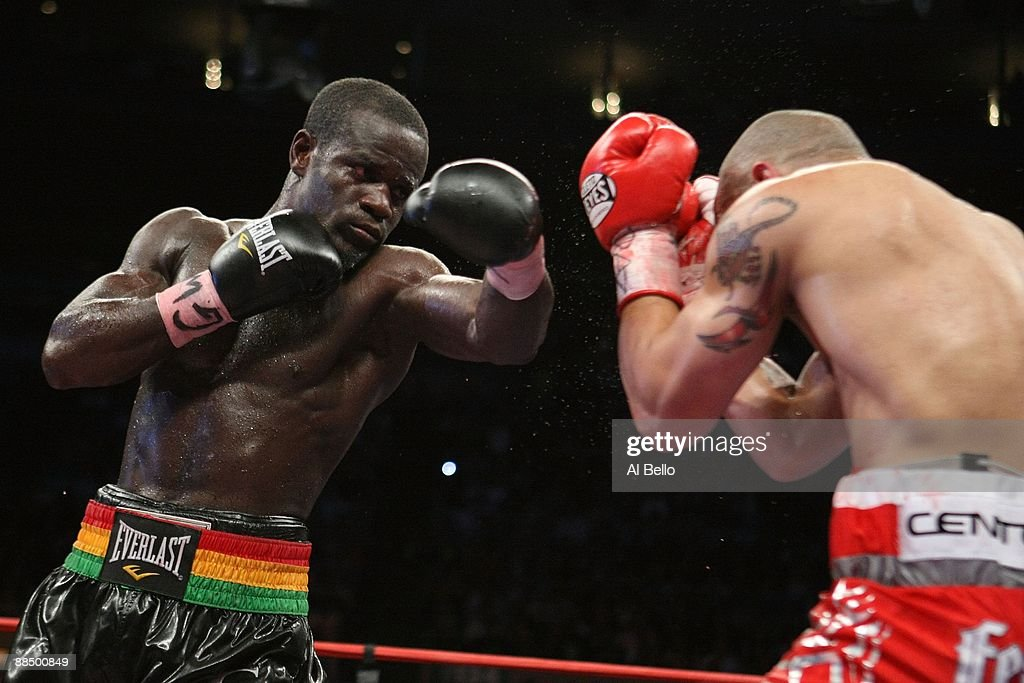 Joshua Clottey punches Miguel Cotto during their WBO Welterweight title fight at Madison Square Garden on June 13 2009 in New York New York