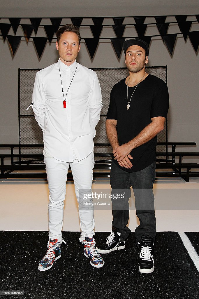 Joshua Cooper and Laurence Chandler pose at the Rochambeau Presentation at Milk Studios on September 8, 2013 in New York City.