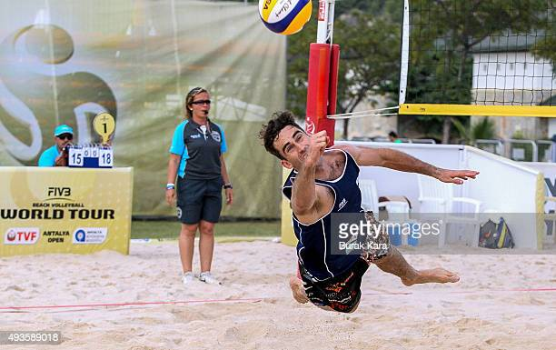 Joshua Court of Aıstralia receives the ball during the 2nd day of the FIVB Antalya Open beach volley tournament October 21 in the Mediterranian...