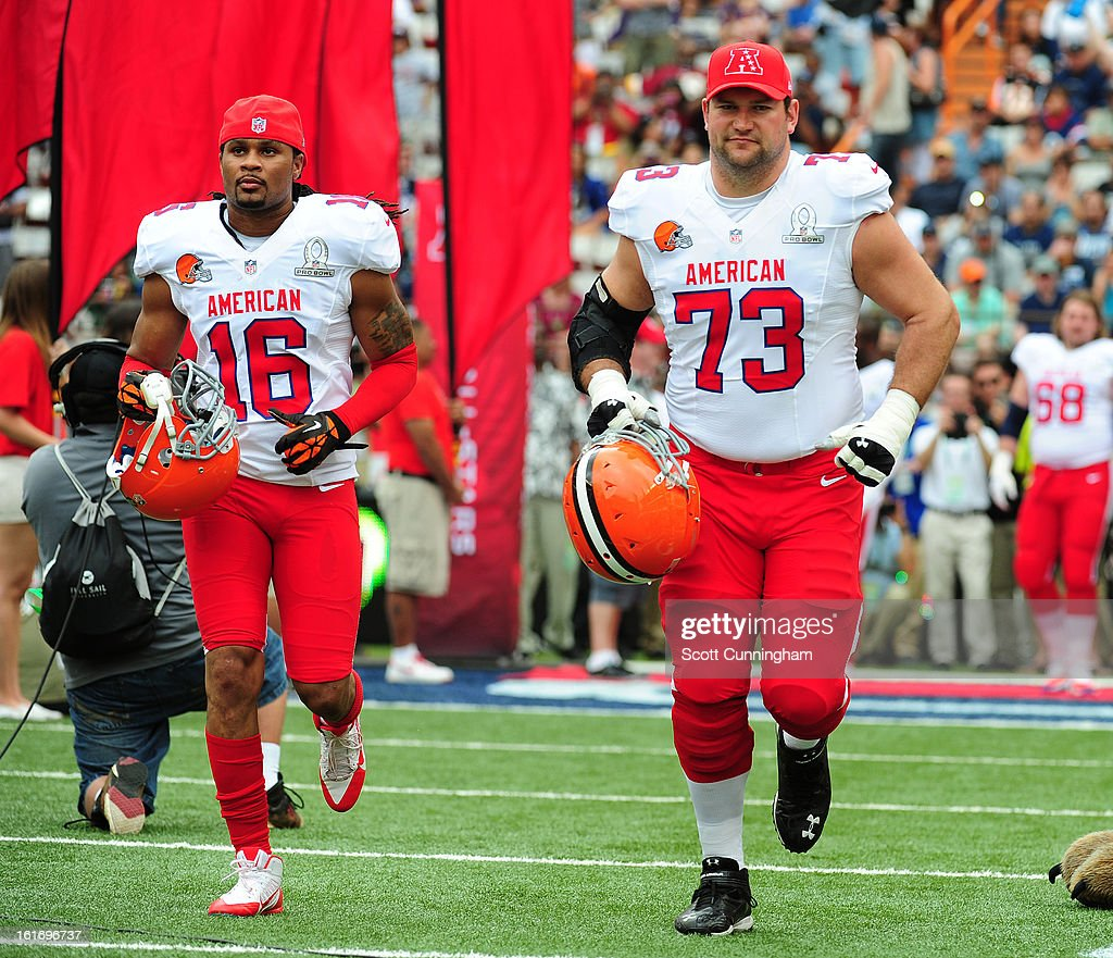 Joshua Cribbs #16 and Joe Thomas #73 of the Cleveland Browns and the AFC are introduced before the 2013 Pro Bowl against the National Football Conference team at Aloha Stadium on January 27, 2013 in Honolulu, Hawaii