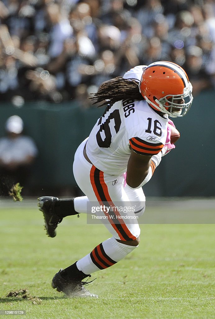 Joshua Cribbs of the Cleveland Browns breaks the tackle of DeMarcus Van Dyke of the Oakland Raiders and runs up field with the ball in the second...
