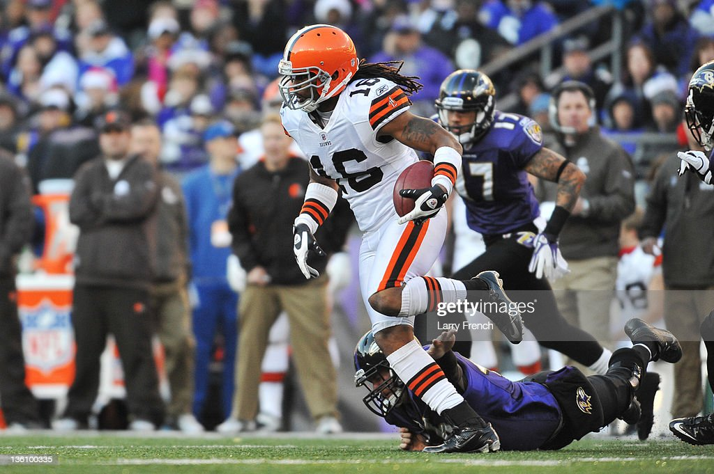 Joshua Cribbs of the Cleveland Browns returns a punt for a touchdown against the Baltimore Ravens at MT Bank Stadium on December 24 2011 in Baltimore...