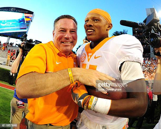 Joshua Dobbs and Coach Butch Jones of the Tennessee Volunteers celebrate after the game against the Georgia Bulldogs at Sanford Stadium on October 1...