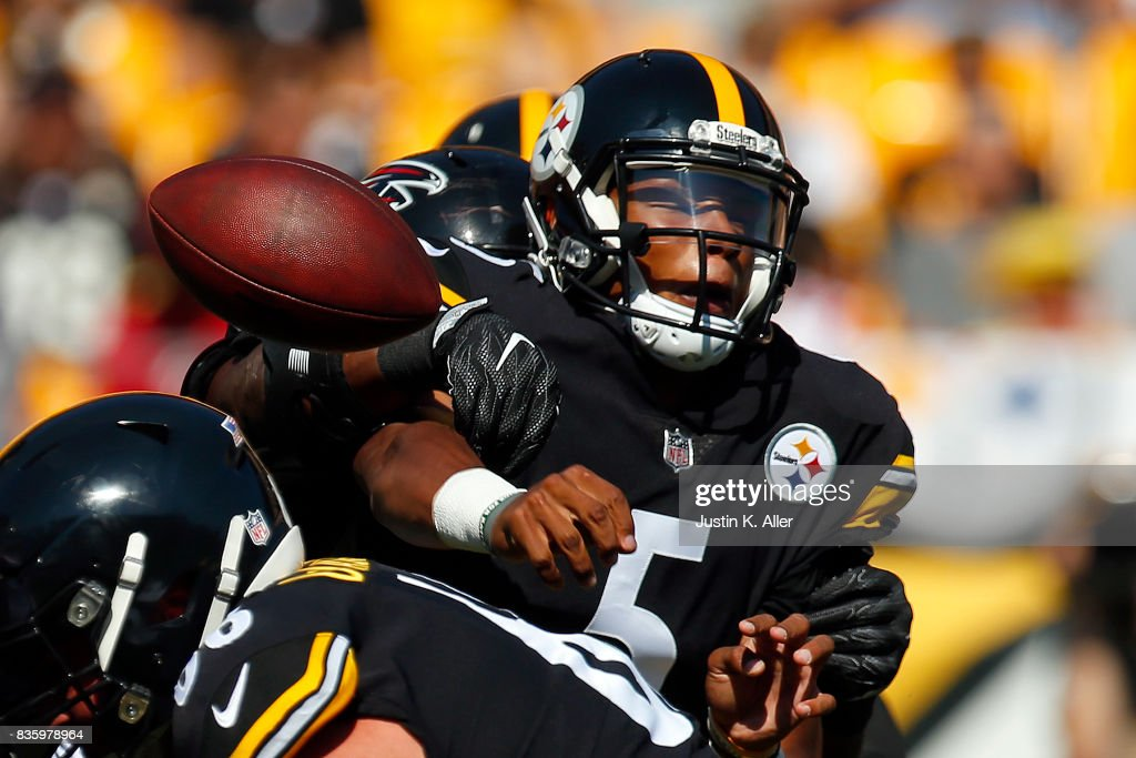Joshua Dobbs #5 of the Pittsburgh Steelers under pressure against the Atlanta Falcons during a preseason game at Heinz Field on August 20, 2017 in Pittsburgh, Pennsylvania.