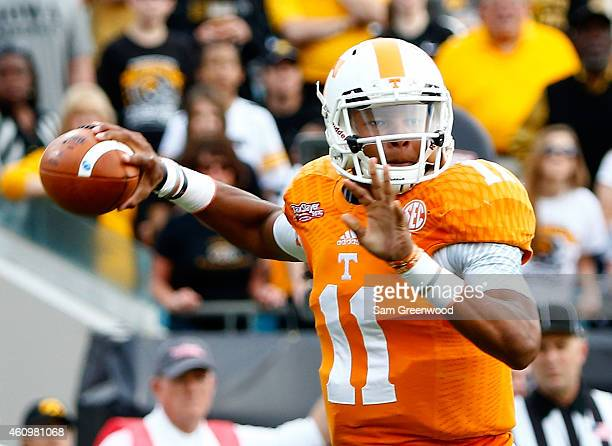 Joshua Dobbs of the Tennessee Volunteers attempts a pass during the TaxSlayer Bowl against the Iowa Hawkeyes at EverBank Field on January 2 2015 in...