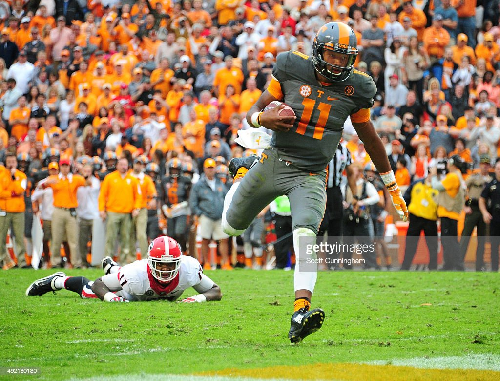 Joshua Dobbs of the Tennessee Volunteers breaks away for a touchdown against the Georgia Bulldogs on October 10 2015 at Neyland Stadium in Knoxville...