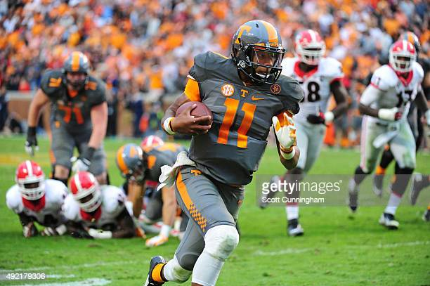 Joshua Dobbs of the Tennessee Volunteers carries the ball against the Georgia Bulldogs on October 10 2015 at Neyland Stadium in Knoxville Tennessee...