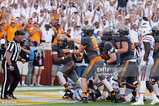 Joshua Dobbs of the Tennessee Volunteers celebrates after rushing for a fiveyard touchdown against the Florida Gators in the fourth quarter at...