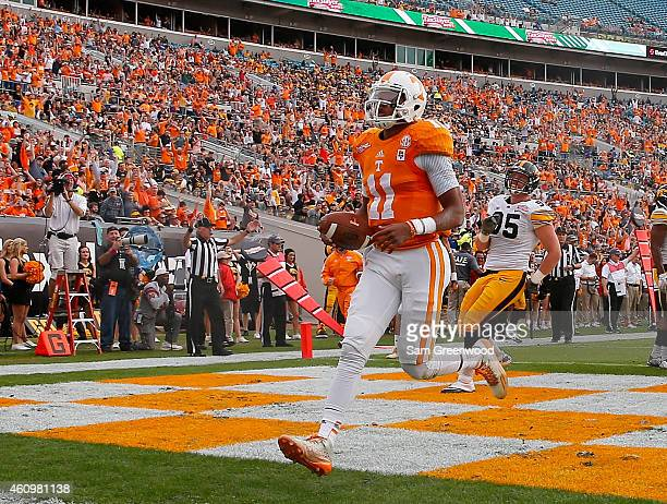 Joshua Dobbs of the Tennessee Volunteers crosses the goal line for a touchdown during the TaxSlayer Bowl against the Iowa Hawkeyes at EverBank Field...