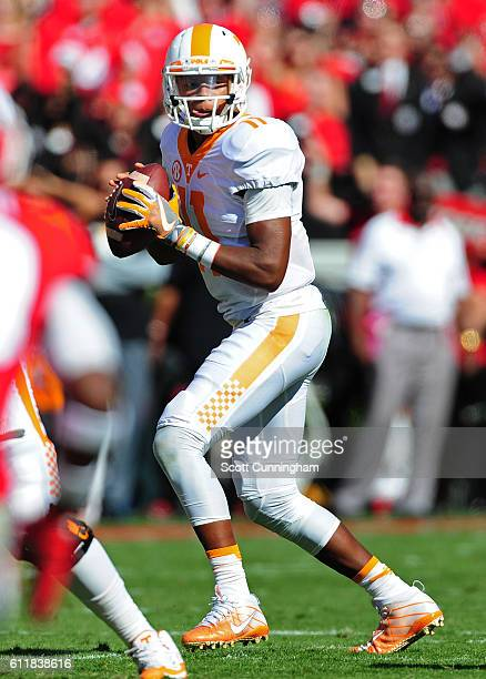Joshua Dobbs of the Tennessee Volunteers drops back to pass against the Georgia Bulldogs at Sanford Stadium on October 1 2016 in Athens Georgia